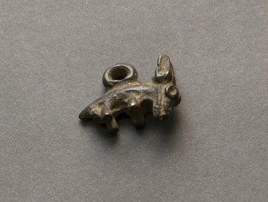 Senufo. <em>Animal Pendant</em>, early 20th century. Bronze, 5/8 x 7/8 x 3/8 in. (1.6 x 2.3 x 1 cm). Brooklyn Museum, Gift of Jerome Vogel, 2012.76.18. Creative Commons-BY (Photo: Brooklyn Museum, 2012.76.18_PS10.jpg)