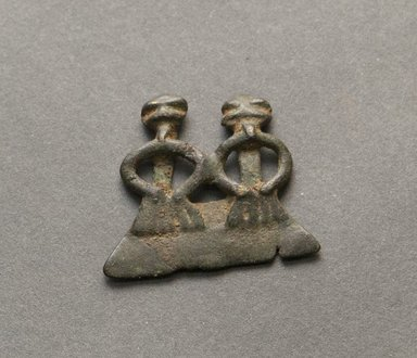 Senufo. <em>Divination Twin Figure</em>, early 20th century. Bronze, 1 x 1 3/16 x 1/8 in. (2.6 x 3 x 0.3 cm). Brooklyn Museum, Gift of Jerome Vogel, 2012.76.21. Creative Commons-BY (Photo: Brooklyn Museum, 2012.76.21_PS10.jpg)