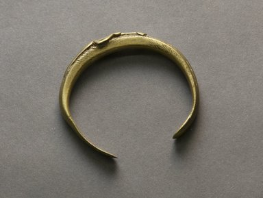 Senufo. <em>Bracelet with Female Figure</em>, early 20th century. Bronze, 1/4 x 2 3/8 in. (0.7 x 6.1 cm). Brooklyn Museum, Gift of Jerome Vogel, 2012.76.5. Creative Commons-BY (Photo: Brooklyn Museum, 2012.76.5_PS10.jpg)