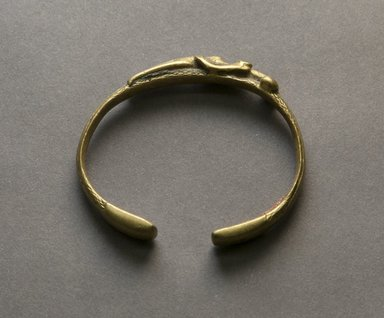 Senufo. <em>Bracelet with Female Figure</em>, early 20th century. Bronze, 7/16 x 2 3/8 in. (1.1 x 6.1 cm). Brooklyn Museum, Gift of Jerome Vogel, 2012.76.6. Creative Commons-BY (Photo: Brooklyn Museum, 2012.76.6_PS10.jpg)
