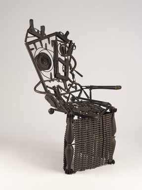 Gonçalo Mabunda (Mozambican, born 1975). <em>Harmony Chair</em>, 2009. Welded weapons (handguns, rifles, land mines, bullets, machine gun belts, rocket-propelled grenades), iron alloy, copper alloy, plastic, wood, and paint, 56 1/8 × 34 1/4 × 26 1/2 in. (142.6 × 87 × 67.3 cm). Brooklyn Museum, Bequest of Samuel E. Haslett, by exchange, gift of Mrs. Morris Friedsam, Georgine Iselin, and Mrs. Joseph M. Schulte, by exchange and Designated Purchase Fund, 2013.26.2. © artist or artist's estate (Photo: Brooklyn Museum, 2013.26.2_threequarter_PS9.jpg)