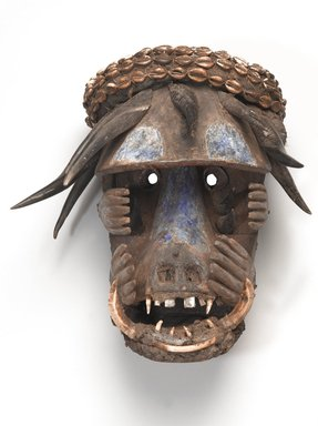 Sapo. <em>Mask (Gela)</em>, 20th century. Wood, metal, cowrie shells, bluing, kaolin, animal teeth, antelope and duiker horn, boar tusk, plant fibers, textile, mud, ceramic, 16 x 14 1/2 x 11 1/2 in. (40.6 x 36.8 x 29.2 cm). Brooklyn Museum, Gift of Mr. and Mrs. J Gordon Douglas III and Dr. and Mrs Milton Gross, by exchange, 2013.61.1. Creative Commons-BY (Photo: Brooklyn Museum, 2013.61.1_overall_PS9.jpg)