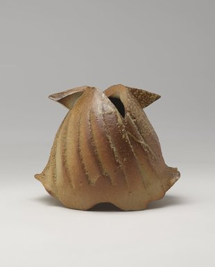 Kakurezaki Ryuichi (Japanese, born 1950). <em>Vase in the Shape of a Helmet</em>, 1995. Stoneware with ash glaze; bizen ware, 6 1/8 x 7 1/2 x 5 7/16 in. (15.5 x 19 x 13.8 cm). Brooklyn Museum, Gift of Shelly and Lester Richter, 2013.83.11. Creative Commons-BY (Photo: Brooklyn Museum, 2013.83.11_side1_PS9.jpg)