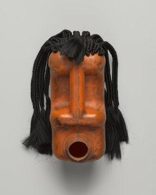 Romuald Hazoumé (Beninese, born 1962). <em>Fiegnon</em>, 2011. Plastic, fiber (possibly synthetic), metal (copper wire), 11 x 8 x 8 1/2 in. (27.9 x 20.3 x 21.6 cm). Brooklyn Museum, Caroline A.L. Pratt Fund, 2014.32.2. © artist or artist's estate (Photo: Brooklyn Museum, 2014.32.2_front_PS9.jpg)