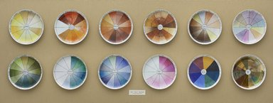 Judy Chicago (American, born 1939). <em>China-painting Color Test Plates</em>, 1974. Porcelain and china paint, twelve plates, display case: 34 3/4 × 84 × 3 1/2 in. (88.3 × 213.4 × 8.9 cm). Brooklyn Museum, Gift of the artist, 2014.71. © artist or artist's estate (Photo: , 2014.71_PS9.jpg)