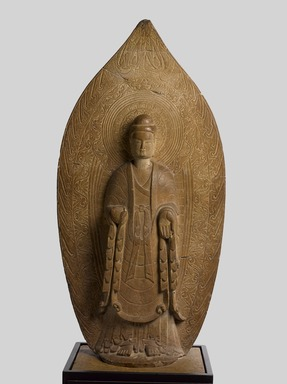 <em>Stele of a Standing Buddha</em>, 534-550 C.E. Sandstone, 53 × 23 × 8 in., 271 lb. (134.6 × 58.4 × 20.3 cm, 122.92kg). Brooklyn Museum, Gift of The Arthur M. Sackler Foundation, NYC, in honor of Arnold Lehman, 2015.3. Creative Commons-BY (Photo: Brooklyn Museum, 2015.3_front_PS9.jpg)