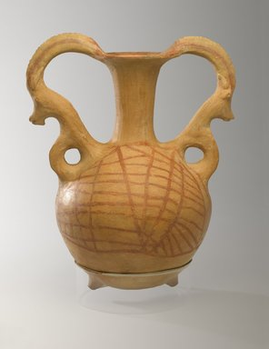 <em>Twin-Spouted Vessel with Mountain Goat Handles</em>, 250-100 B.C.E. Clay, slip, height 13 1/16 x diam. 10 1/2 x width 8 1/16 in. (33.1 x 26.6 x 20.4 cm). Brooklyn Museum, Gift of the Arthur M. Sackler Foundation, NYC, in memory of James F. Romano, 2015.65.14. Creative Commons-BY (Photo: Brooklyn Museum, 2015.65.14_PS9.jpg)