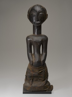 Hemba artist. <em>Commemorative Figure (Singiti)</em>, early 20th century. Wood, cotton, organic materials, 26 3/4 × 9 3/4 × 8 1/4 in. (67.9 × 24.8 × 21 cm). Brooklyn Museum, Gift of the Ralph and Fanny Ellison Charitable Trust, 2015.88.2. Creative Commons-BY (Photo: Brooklyn Museum, 2015.88.2_front_PS9.jpg)