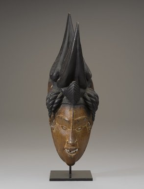 Igbo artist. <em>Okoroshi Mask</em>, early 20th century. Wood, pigment, without mount: 14 9/16 x 4 3/4 in. (37 x 12 cm). Brooklyn Museum, Gift of the Ralph and Fanny Ellison Charitable Trust, 2015.88.3. Creative Commons-BY (Photo: Brooklyn Museum, 2015.88.3_front_PS9.jpg)