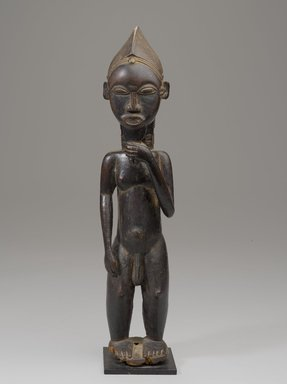 Baule artist. <em>Figure of a Male</em>. Wood, pigment, organic materials, upholstery stud, with mount: 16 7/8 x 5 in. (42.8 x 12.7 cm). Brooklyn Museum, Gift of the Ralph and Fanny Ellison Charitable Trust, 2015.88.6. Creative Commons-BY (Photo: Brooklyn Museum, 2015.88.6_front_PS9.jpg)