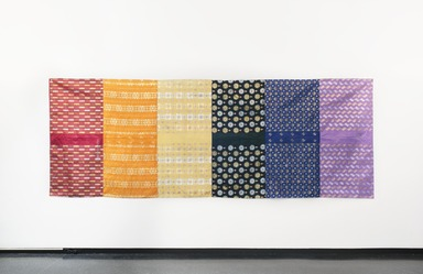 Adejoke Tugbiyele (American, born 1977). <em>Gele Pride Flag</em>, 2014. Fabric, metallic thread, brass, 64 x 175 in. (162.6 x 444.5 cm). Brooklyn Museum, Gift of the artist in honor of the LGBTQ brothers and sisters we lost in Orlando, 2016.24. © artist or artist's estate (Photo: , 2016.24_PS11.jpg)