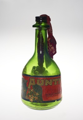 Betye Saar (American, born 1926). <em>Liberation of Aunt Jemima: Cocktail</em>, 1973. Glass, paper, textile, metal, Overall: 12 1/2 × 5 3/4 in. (31.8 × 14.6 cm). Brooklyn Museum, Purchased with funds given by Elizabeth A. Sackler, gift of the Contemporary Art Committee, and William K. Jacobs, Jr. Fund, 2017.17. © artist or artist's estate (Photo: , 2017.17_front_PS11.jpg)