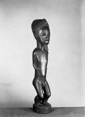 Baule. <em>Male Figure (Blolo bian)</em>, early 20th century. Wood, pigment, 14 15/16 x 3 3/8 x 3 in. (38 x 8.5 x 7.6 cm). Brooklyn Museum, Museum Expedition 1922, Robert B. Woodward Memorial Fund, 22.1091. Creative Commons-BY (Photo: Brooklyn Museum, 22.1091_threequarter_front_acetate_bw.jpg)