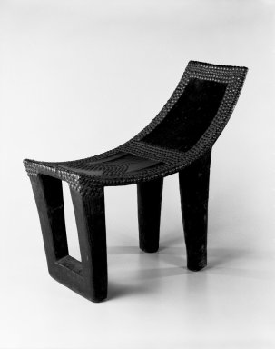 Ngombe. <em>Chief's Seat (Ekele)</em>, late 19th century. Wood, copper alloy, applied material, 20 3/4 x 10 1/2 x 23 1/2 in. (52.7 x 26.7 x 59.7 cm). Brooklyn Museum, Museum Expedition 1922, Robert B. Woodward Memorial Fund, 22.1109. Creative Commons-BY (Photo: Brooklyn Museum, 22.1109_bw.jpg)