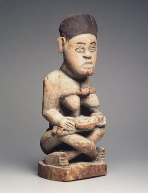 Yombe. <em>Mother and Child Figure</em>, late 19th or early 20th century. Wood, pigment, 21 1/2 x 8 x 8 1/2in. (54.6 x 20.3 x 21.6cm). Brooklyn Museum, Museum Expedition 1922, Robert B. Woodward Memorial Fund, 22.1139. Creative Commons-BY (Photo: Brooklyn Museum, 22.1139_transp6186.jpg)