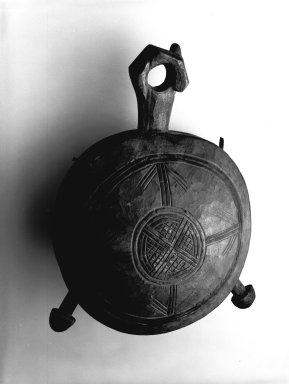 Yombe. <em>Bell (Dibu)</em>, late 19th-early 20th century. Wood, pigment, skin thong, applied material, 13 1/2 x 9 1/4 x 6 1/4 in. (34.3 x 23.5 x 15.9 cm). Brooklyn Museum, Museum Expedition 1922, Robert B. Woodward Memorial Fund, 22.1327. Creative Commons-BY (Photo: Brooklyn Museum, 22.1327_bw.jpg)