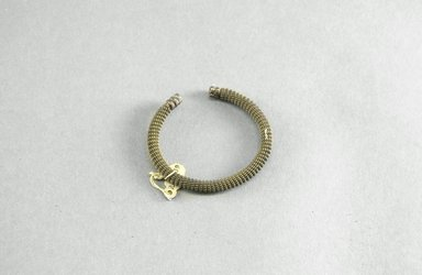 <em>Bracelet</em>. Brass, 2 11/16 in. (6.8 cm). Brooklyn Museum, Museum Expedition 1922, Robert B. Woodward Memorial Fund, 22.1339. Creative Commons-BY (Photo: Brooklyn Museum, 22.1339_PS5.jpg)