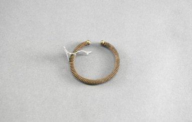 <em>Bracelet</em>. Brass Brooklyn Museum, Museum Expedition 1922, Robert B. Woodward Memorial Fund, 22.1341. Creative Commons-BY (Photo: Brooklyn Museum, 22.1341_PS5.jpg)