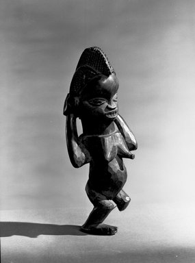 Mbala. <em>Figure of a Standing Female (Pindi)</em>, late 19th or early 20th century. Wood, 7 1/2 x 3 x 3 in. (18.8 x 7.5 x 7.5 cm). Brooklyn Museum, Museum Expedition 1922, Robert B. Woodward Memorial Fund, 22.134. Creative Commons-BY (Photo: Brooklyn Museum, 22.134_acetate_bw.jpg)