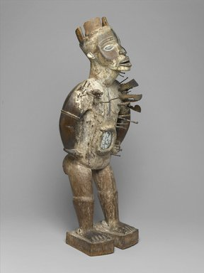 Kakongo artist. <em>Power Figure (Nkisi Nkondi)</em>, 19th century. Wood, iron, glass mirror, resin, kaolin, pigment, plant fiber, 33 7/8 x 13 3/4 x 11 in. (86 x 34.9 x 27.9 cm). Brooklyn Museum, Museum Expedition 1922, Robert B. Woodward Memorial Fund, 22.1421. Creative Commons-BY (Photo: Brooklyn Museum, 22.1421_threequarter_PS1.jpg)
