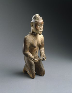 Yombe. <em>Kneeling Woman Holding a Pipe</em>, 19th century. Wood, pigment, glass mirror, fiber, copper alloy, 9 13/16 x 3 15/16 x 3 3/4 in. (25 x 10 x 9.5 cm). Brooklyn Museum, Museum Expedition 1922, Robert B. Woodward Memorial Fund, 22.1426. Creative Commons-BY (Photo: Brooklyn Museum, 22.1426_edited_version_SL1.jpg)