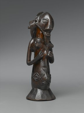 Luba. <em>Kabwelulu Gourd Figure</em>, 19th century. Wood, metal, 7 3/4 x 2 7/8 x 2 3/4 in. (19.7 x 7.3 x 7 cm). Brooklyn Museum, Museum Expedition 1922, Robert B. Woodward Memorial Fund, 22.1454. Creative Commons-BY (Photo: Brooklyn Museum, 22.1454_threequarter_PS2.jpg)