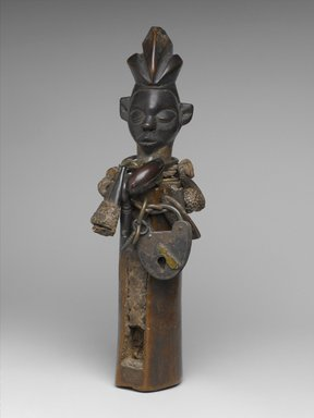 Yaka. <em>Slit-Drum Hunting Charm (N-kookwa Ngoombu)</em>, 19th century. Wood, iron, seedpods, fiber, horn, fur, glass, beads, organic material, 12 3/16 x 2 3/4 x 2 in. (31 x 7 x 5.1 cm). Brooklyn Museum, Museum Expedition 1922, Robert B. Woodward Memorial Fund, 22.1461. Creative Commons-BY (Photo: Brooklyn Museum, 22.1461_PS2.jpg)