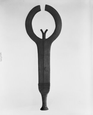 Ngbaka. <em>Executioner's Sword</em>, late 19th or early 20th century. Copper alloy, wire, 7 5/16 x 20 11/16 in. (18.5 x 52.5 cm). Brooklyn Museum, Museum Expedition 1922, Robert B. Woodward Memorial Fund, 22.1502. Creative Commons-BY (Photo: Brooklyn Museum, 22.1502_bw.jpg)