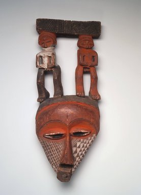 Pende (Eastern). <em>Triangular Mask Surmounted by Male and Female Figures</em>, 19th century. Wood, pigment, pyro, 15 3/4 x 6 1/2 x 3 1/4in. (40 x 16.5 x 8.3cm). Brooklyn Museum, Museum Expedition 1922, Robert B. Woodward Memorial Fund, 22.1690. Creative Commons-BY (Photo: Brooklyn Museum, 22.1690.jpg)