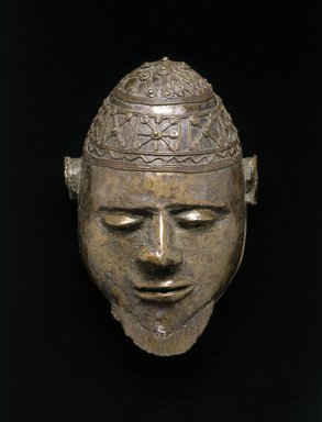 Ali Amonikoyi (Nigerian, 1880-1920). <em>Mask</em>, ca. 1910. Copper alloy, 10 1/2 x 7 1/4 x 5 1/2 in.  (26.7 x 18.4 x 14.0 cm). Brooklyn Museum, Museum Expedition 1922, Robert B. Woodward Memorial Fund, 22.1692. Creative Commons-BY (Photo: Brooklyn Museum, 22.1692_SL1.jpg)