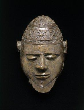 Ali Amonikoyi (Nigerian, 1880-1920). <em>Mask</em>, ca. 1910. Copper alloy, 10 1/2 x 7 1/4 x 5 1/2 in.  (26.7 x 18.4 x 14.0 cm). Brooklyn Museum, Museum Expedition 1922, Robert B. Woodward Memorial Fund, 22.1692. Creative Commons-BY (Photo: Brooklyn Museum, 22.1692_SL1.jpg)