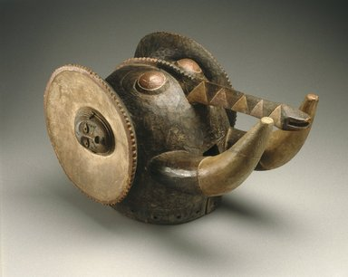 Baule. <em>Elephant Mask (Glao/Klolo)</em>, late 19th century. Wood, pigment, metal, 12 5/8 x 12 5/8 x 22 13/16 in. (32.0 x 32.0 x 58.0 cm). Brooklyn Museum, Museum Expedition 1922, Purchased with funds given by Frederic B. Pratt, 22.1771. Creative Commons-BY (Photo: Brooklyn Museum, 22.1771_edited_version_SL1.jpg)