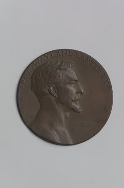 John Flanagan (American, 1865-1952). <em>Portrait Medal of Paul Wayland Bartlett</em>, 1917. Bronze, 4 11/16 x 4 11/16 x 3/16 in. (11.9 x 11.9 x 0.5 cm). Brooklyn Museum, Robert B. Woodward Memorial Fund, 22.1958.1. Creative Commons-BY (Photo: Brooklyn Museum, 22.1958.1.jpg)