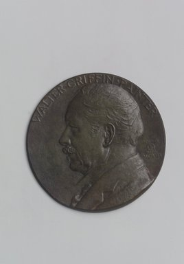 John Flanagan (American, 1865-1952). <em>Portrait Medal of Walter Griffin</em>, 1919. Bronze, 4 5/8 x 4 5/8 x 3/8 in. (11.7 x 11.7 x 1 cm). Brooklyn Museum, Robert B. Woodward Memorial Fund, 22.1958.3. Creative Commons-BY (Photo: Brooklyn Museum, 22.1958.3.jpg)
