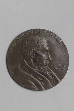 John Flanagan (American, 1865-1952). <em>Portrait Medal of Joseph Pennell</em>, 1919. Bronze, 4 11/16 x 4 11/16 x 1/8 in. (11.9 x 11.9 x 0.3 cm). Brooklyn Museum, Robert B. Woodward Memorial Fund, 22.1958.6. Creative Commons-BY (Photo: Brooklyn Museum, 22.1958.6.jpg)