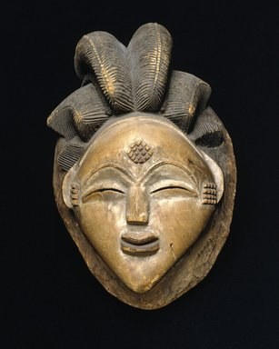 Punu. <em>Mask for the Okuyi Society (Mukudj)</em>, late 19th century. Wood, pigment, 9 7/8 x 7 x 6in. (25.1 x 17.8 x 15.2cm). Brooklyn Museum, Museum Expedition 1922, Robert B. Woodward Memorial Fund, 22.225. Creative Commons-BY (Photo: Brooklyn Museum, 22.225_SL1_edited_version.jpg)