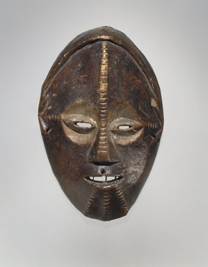 Ngbandi. <em>Mask</em>, 19th century. Wood, pigment, 10 1/2 x 6 5/8 x 2 3/4 in. (26.7 x 16.8 x 7 cm). Brooklyn Museum, Museum Expedition 1922, Robert B. Woodward Memorial Fund, 22.226. Creative Commons-BY (Photo: Brooklyn Museum, 22.226_edited_version_SL1.jpg)