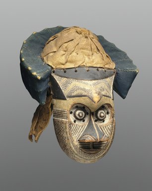 Kuba (Bushoong subgroup). <em>Mask (Pwoom Itok)</em>, late 19th century. Wood, shell, cloth, raffia, pigment, 15 3/8 x 11 1/4 x 11 3/4 in. (39.1 x 28.6 x 29.8 cm). Brooklyn Museum, Museum Expedition 1922, Robert B. Woodward Memorial Fund, 22.230. Creative Commons-BY (Photo: Brooklyn Museum, 22.230_SL1.jpg)