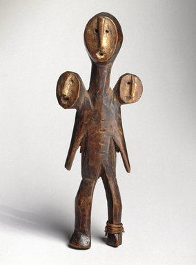 Lega. <em>Three-Headed Figure (Sakimatwemtwe)</em>, 19th century. Wood, fiber, kaolin, 5 1/2 x 2 x 1 1/8 in. (14 x 5.1 x 2.9 cm). Brooklyn Museum, Museum Expedition 1922, Robert B. Woodward Memorial Fund, 22.486. Creative Commons-BY (Photo: Brooklyn Museum, 22.486_SL1_edited_version.jpg)