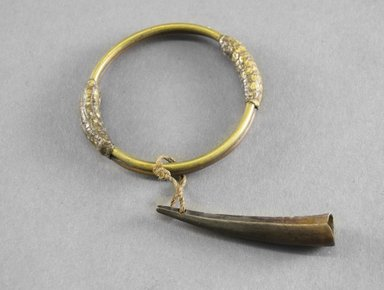<em>Bracelet</em>. Brass, snakeskin, bone Brooklyn Museum, Museum Expedition 1922, Robert B. Woodward Memorial Fund, 22.725. Creative Commons-BY (Photo: Brooklyn Museum, 22.725_front_PS5.jpg)