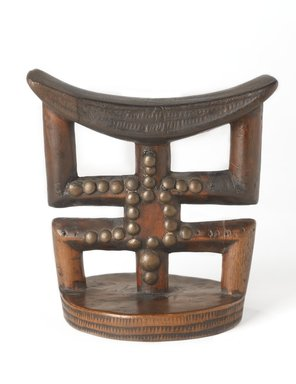 Banfumu. <em>Headrest</em>, late 19th or early 20th century. Wood, copper alloy, 5 1/2 x 5 1/4 in. (14 x 13.3 cm). Brooklyn Museum, Museum Expedition 1922, Robert B. Woodward Memorial Fund, 22.811. Creative Commons-BY (Photo: Brooklyn Museum, 22.811_PS9.jpg)