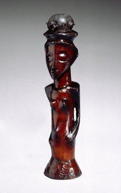 Kasongo. <em>Female Figure with Medicinal Charge (Musinju)</em>, 19th century. Wood, metal, resin, 8 1/2 x 2 1/2 x 2 in. (21.6 x 6.4 x 5.1 cm). Brooklyn Museum, Museum Expedition 1922, Robert B. Woodward Memorial Fund, 22.817. Creative Commons-BY (Photo: Brooklyn Museum, 22.817_SL1_edited_version.jpg)