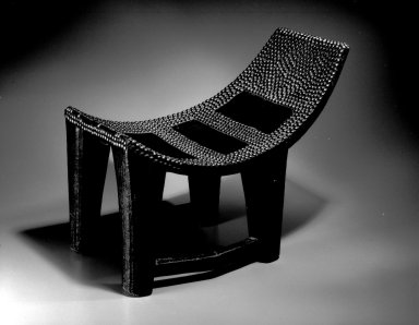 Ngombe. <em>Chief's Seat (Ekele)</em>, late 19th or early 20th century. Wood, brass, 13 3/8 x 20 1/2 x 10 1/2 in. (34 x 52.1 x 26.7 cm). Brooklyn Museum, Museum Expedition 1922, Robert B. Woodward Memorial Fund, 22.877. Creative Commons-BY (Photo: Brooklyn Museum, 22.877_bw.jpg)