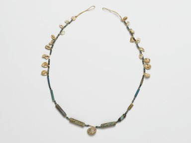 <em>Necklace</em>, ca. 2008-1630 B.C.E. Faience, shell (marine Cypraea moneta and Xeropicta vestalis), 1/2 x 1/4 x 19 1/8 in. (1.3 x 0.6 x 48.6 cm). Brooklyn Museum, Gift of the Egypt Exploration Society, 26.167. Creative Commons-BY (Photo: Brooklyn Museum, 26.167_PS2.jpg)