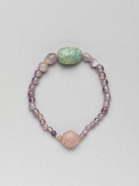 <em>Necklace with Uninscribed Scarab</em>, ca. 1938-1875 B.C.E. Amethyst, feldspar, Overall Diam. 2 3/16 in. (5.5 cm). Brooklyn Museum, Gift of the Egypt Exploration Society , 26.47. Creative Commons-BY (Photo: , 26.47_front_PS9.jpg)