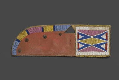 Oglala, Lakota, Sioux. <em>Knife Sheath, Part of War Outfit</em>, late 19th-early 20th century. Rawhide, pigment, beads, nails, 13 1/2 x 4 1/2 in. (34.3 x 11.4 cm). Brooklyn Museum, Robert B. Woodward Memorial Fund, 26.788. Creative Commons-BY (Photo: Brooklyn Museum, 26.788_PS1.jpg)