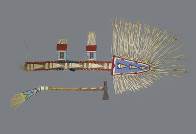 Crow. <em>Spear Case</em>, late 19th century. Hide, beads, wool, cloth, with fringe: 59 1/2 x 20 in. (151.1 x 50.8 cm). Brooklyn Museum, Robert B. Woodward Memorial Fund, 26.792. Creative Commons-BY (Photo: , 26.792_26.802_PS1.jpg)