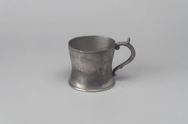 Attributed to William Calder (American, 1817-1856). <em>Cup with Handle</em>, 1817-1856. Pewter, 2 7/8 x 3 7/8 x 2 7/8 in. (7.3 x 9.8 x 7.3 cm). Brooklyn Museum, Gift of Mrs. Samuel Doughty, 27.463. Creative Commons-BY (Photo: Brooklyn Museum, 27.463.jpg)