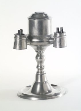 Yale and Curtis. <em>Lamp</em>, 1858-1867. Pewter, Overall: 8 1/4 x 5 1/4 x 5 in. (21 x 13.3 x 12.7 cm). Brooklyn Museum, Gift of Mrs. Samuel Doughty, 27.527. Creative Commons-BY (Photo: Brooklyn Museum, 27.527_transp934.jpg)