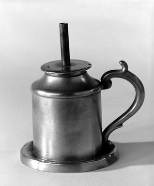 Capen and Molineux. <em>Lamp</em>, 1848-1854. Pewter, copper (?), 3 7/8 x 3 1/2 x 2 3/4 in. (9.8 x 8.9 x 7 cm). Brooklyn Museum, Gift of Mrs. Samuel Doughty, 27.575. Creative Commons-BY (Photo: Brooklyn Museum, 27.575_bw.jpg)